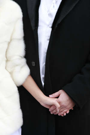 agrees: Newly married pair. Female hand in mans hands.