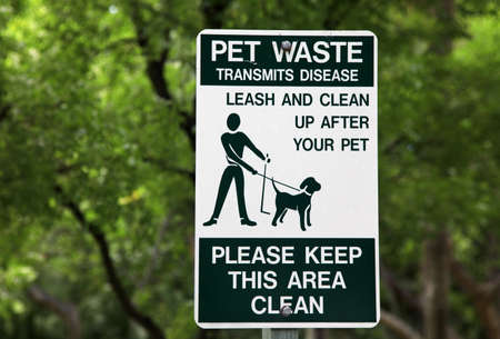 poop: Pet waste sign at the park in Miami Stock Photo
