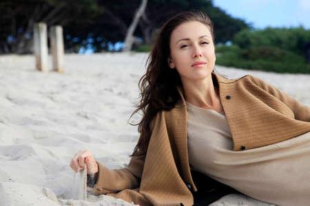 admires: The girl on coastline ocean admires nature