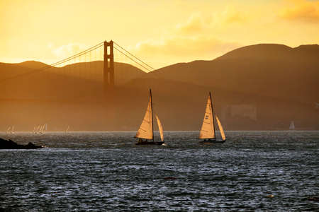 Golden Gate Bridge Skyline with tanker silhouette in San Francisco, USA photo