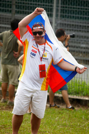malaisia: MALAISIA, SEPANG 04 APRIL 2010: Russian fan on Malaysian Grand Prix at Sepang F1 first circuit April 04, 2010 in Sepang Editorial