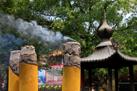 Burning incense sticks in stone bowl in Hong Kong photo