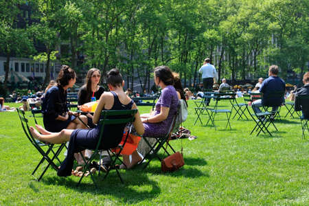 bryant park: NEW YORK, USA - MAY 16: People enjoying a nice day in Bryant Park on May 16, 2013 in New York City, NY. Bryant Park is a 9,603 acre privately managed park in the center of Manhattan.