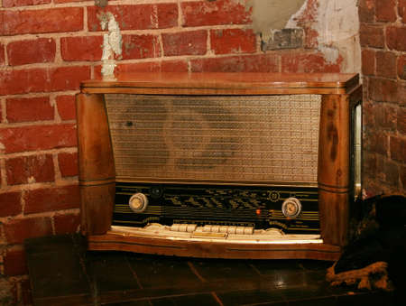 grunge wall and old radio on floor photo
