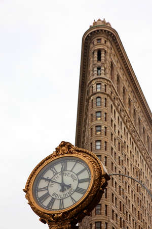 corner clock: Flatiron building, Fifth avenue, Manhattan, New York, USA.