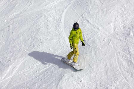 serf: Snowboarder riding fresh powder snow