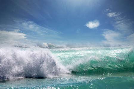 breaking wave: Big ocean wave breaking the shore