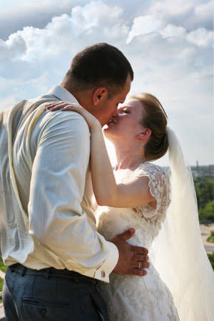 Beautiful the bride and the groom kiss photo