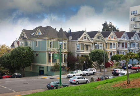 San Francisco, California, USA - October 23, 2012: View of part of the Painted Ladies house , a series of Victorian style house along Alamo Square park in San Francisco in on a cloudy day.