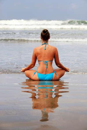 inhale: Meditation girl yoga on the beach Stock Photo