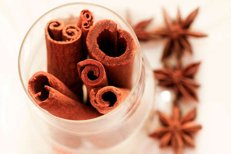 anice: anice and cinnamon isolated on white background Stock Photo