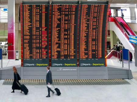 charles de gaulle: Paris, France - September 16, 2010: Flight announcement shows time of departure on a screen, airport Charles de Gaulle in Paris, France Editorial