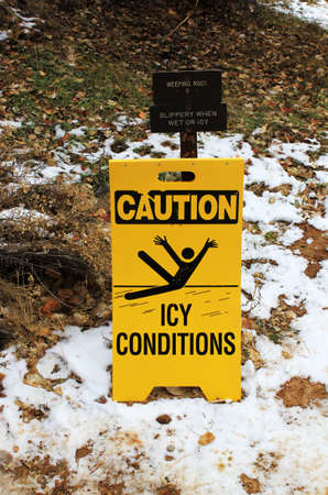 inclement: caution ice conditions on a slope of mountain Editorial
