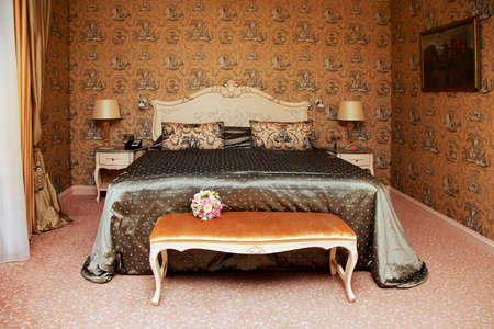 romantic room: Nice bedroom with the big bed. Stock Photo