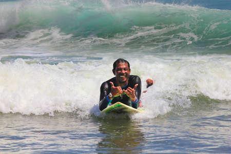 bodyboarding: Young men - the surfer in ocean. Bali. Indonesia