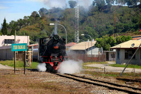 wood railroad: Kota Kinabalu, Malaysia - January 03, 2015: Tourist train North Borneo Railway is an old steam colonial era (engine runs on burning wood). This is a joint project between the railroad and the resort Sabah Sutera Harbour Resort. Currently, tourist train ru