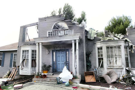 house facades: House damaged by disaster. Scenery for cinema