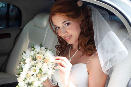 elation: The beautiful bride in the automobile