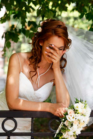 debutante: The beautiful bride on a green background Stock Photo