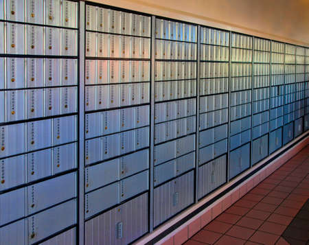 public address: Post office mail boxes lining a wall outside