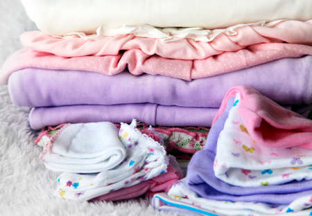 dowry: Pile of baby clothes Stock Photo