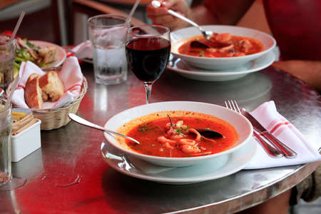 seafood soup: Bowl of spicy fish soup with tomatoes and mussels Stock Photo