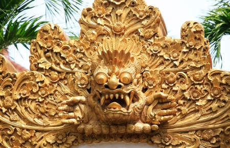 daunting: Hundreds years old carving at Pura in Bali Stock Photo