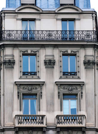 convoluted: The facade of apartment building in Paris
