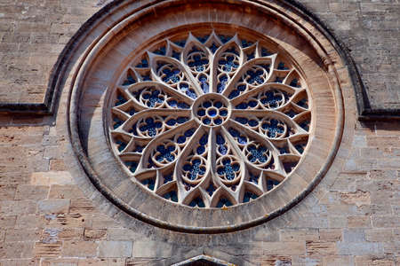 exterior shape: stained glass window in a church in the old town in Alcudia