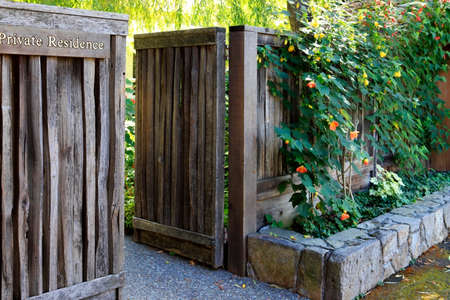 material flower: Image of garden with plants, wooden fence