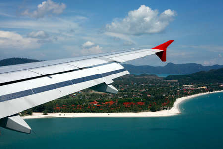 soft hail: Wing of the plane on a background of island Langkawi Stock Photo