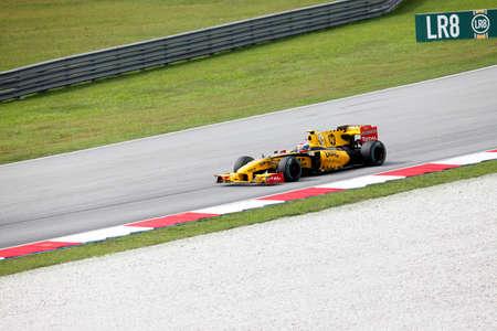petronas: SEPANG, MALAYSIA - APRIL 4 : Renault F1 driver Vitaly Petrov of Russia drives during Petronas Malaysian Grand Prix at Sepang F1 circuit April 4, 2010 in Sepang
