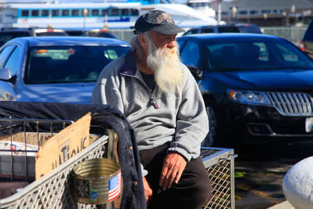 ca he: San Francisco, CA, USA - October 22, 2012: Homeless Man with Shopping Cart on the streets in San Francisco. He carries all of his belongings with him in a shopping cart