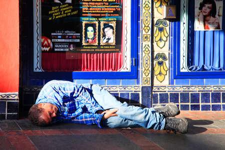 San Francisco, CA, USA - October 23, 2012: Homeless man sleeps on the street Castro in the center of San Francisco Editorial