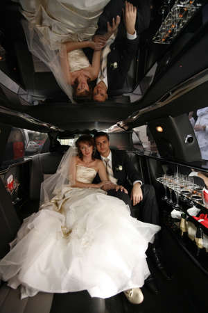 Newly-married couple in car photo