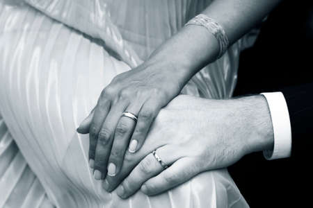 agrees: Female hands in mans hands with wedding rings Stock Photo