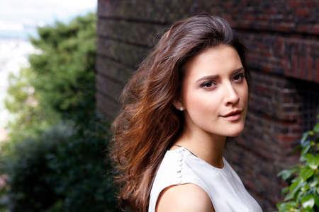 brunet: Portrait of a beautiful brunette outdoors Stock Photo