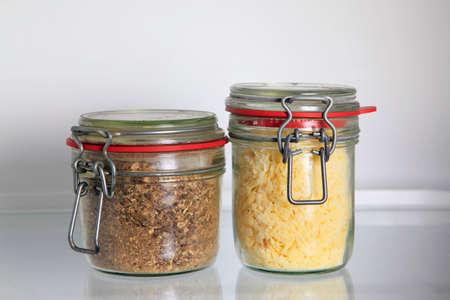 glass jars: Glass jars on the shelf of the refrigerator