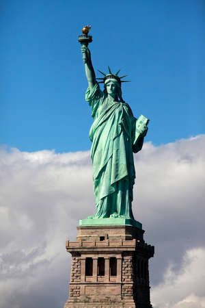 statue of liberty: Statue of Liberty on Liberty Island in New York City. - isolated on blue sky background Stock Photo
