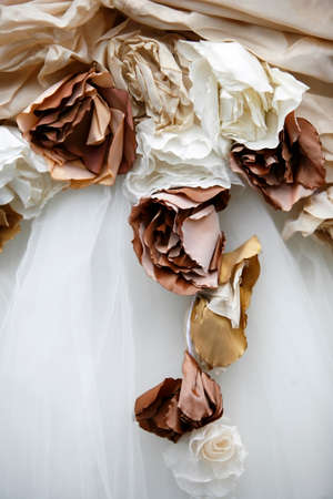 evening gowns: Detail of a wedding dress with colors from a fabric