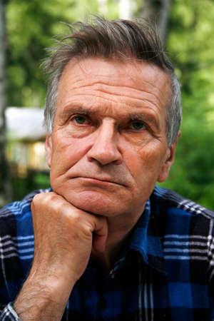 wrinkled: Portrait of the elderly tired man