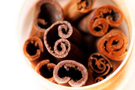 badiane: Cinnamon close-up isolated on white background