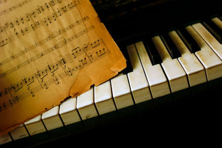 old books: The keyboard of the piano and old notes Stock Photo
