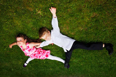 at close quarters: Brother and sister outdoors smiling Stock Photo