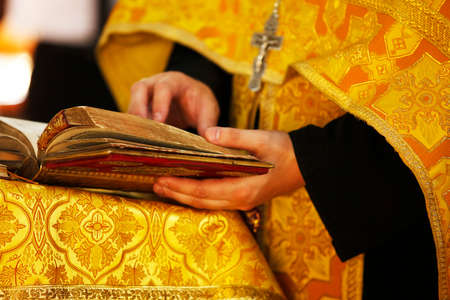 church people: The Bible in hands of the priest