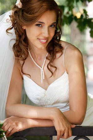 elation: The beautiful bride on a green background Stock Photo