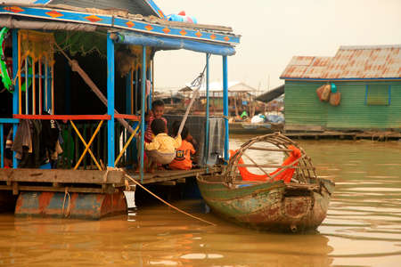 tonle sap: SIEM REAP, CAMBODIA - APRIL 06, 2014: Traditional village life in Kampong Phluck on Tonle Sap Lake Editorial