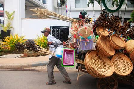 penh: Phnom Penh, Cambodia, April 5th 2014: Seller wicker baskets on the streets of Phnom Penh
