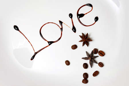 syrupy: Love written with dark cocoa isolated in white Stock Photo