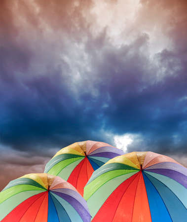 rainbow umbrella: Rainbow umbrella against blue sky